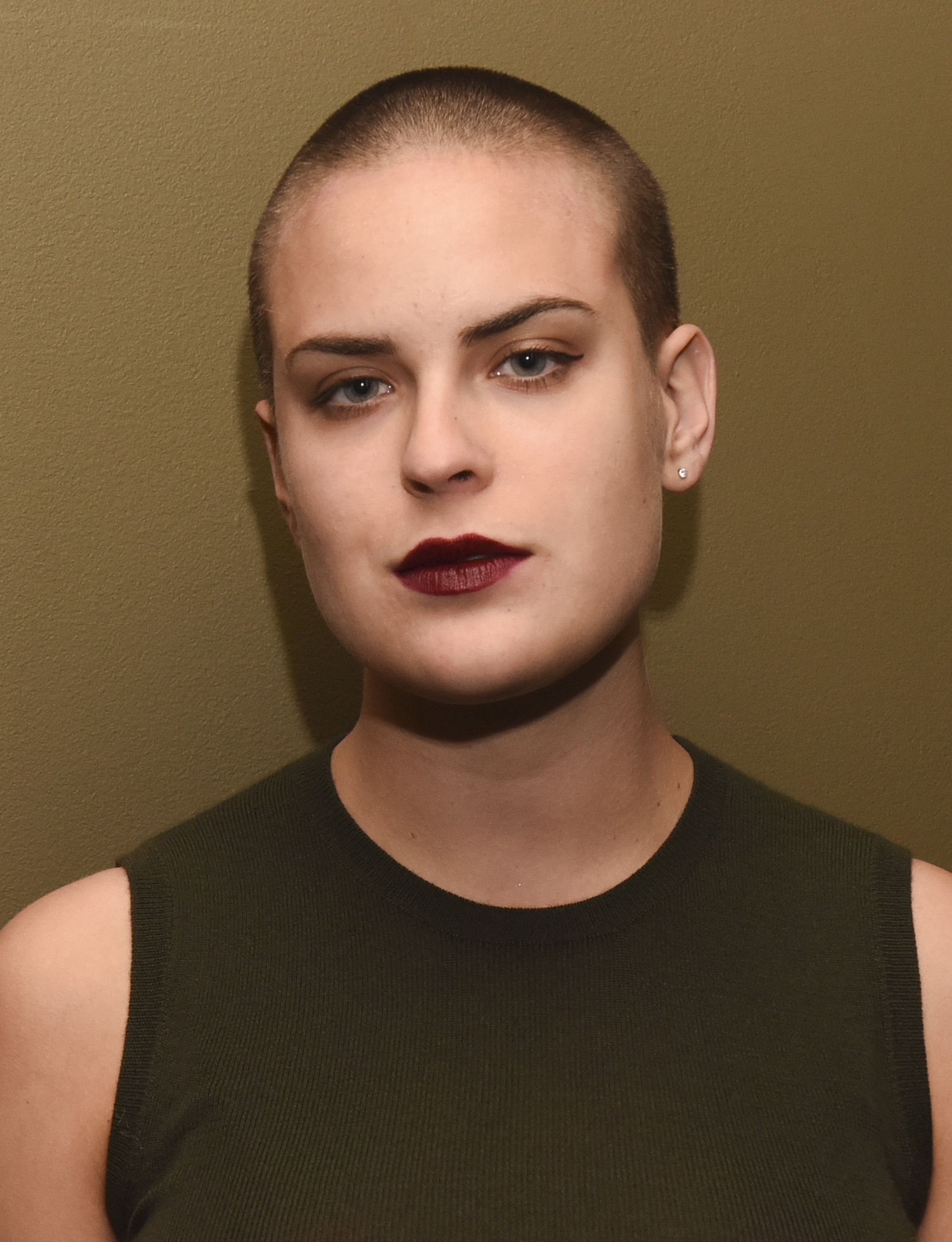 Buzz A. reccomend Shaved head female rock star