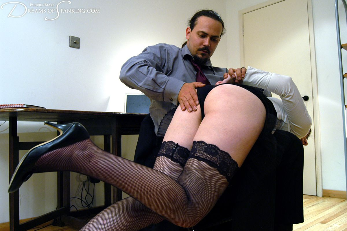 Erotic spanking over pantyhose